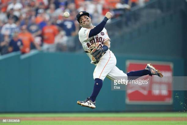 Jose Altuve of the Houston Astros fields a single by Starlin Castro of the New York Yankees during game two of the American League Championship...