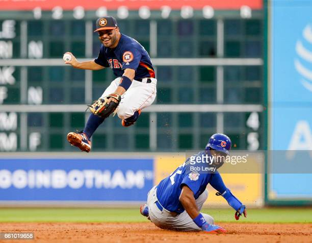 Jose Altuve of the Houston Astros forces out Jason Heyward of the Chicago Cubs in the second inning during an exhibition game at Minute Maid Park on...