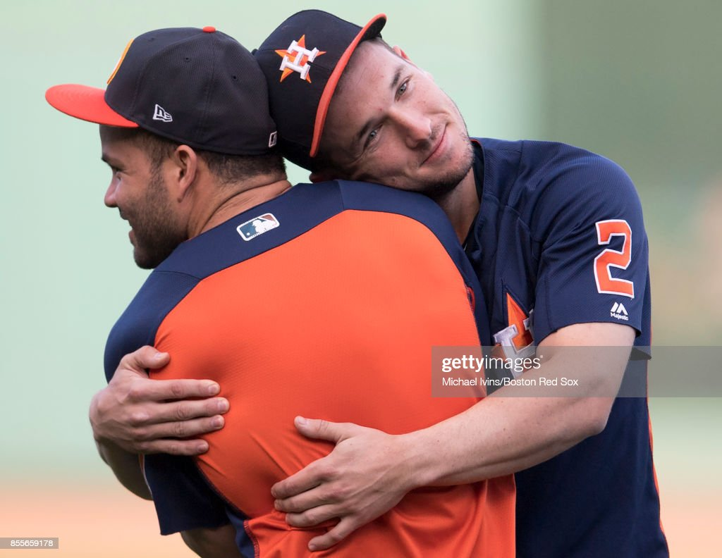 Jose Altuve #27 of the Houston Astros gets a hug from Alex Bregman #2 during warmups before a game against the Boston Red Sox at Fenway Park on September 29, 2017 in Boston, Massachusetts.