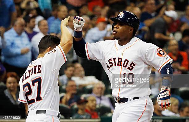 Jose Altuve of the Houston Astros greets teammate Luis Valbuena after Valbuena hit a solo home run in the sixth inning of their game against the San...