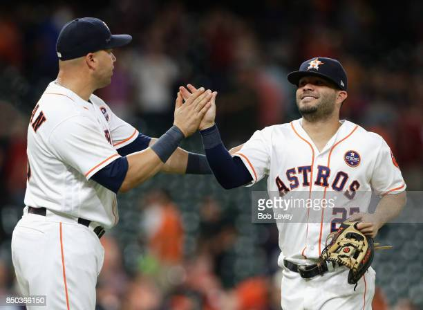 Jose Altuve of the Houston Astros high fives Carlos Beltran after the final out at Minute Maid Park on September 20 2017 in Houston Texas