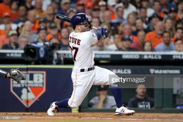 Jose Altuve of the Houston Astros hits a double against the New York Yankees during the first inning in game six of the American League Championship...