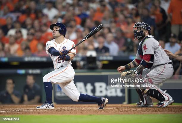 Jose Altuve of the Houston Astros hits a home run his third of the game against the Boston Red Sox in the seventh inning of game one of the American...