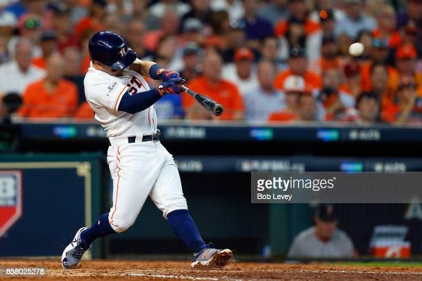 Jose Altuve of the Houston Astros hits a home run in the fifth inning against the Boston Red Sox during game one of the American League Division...