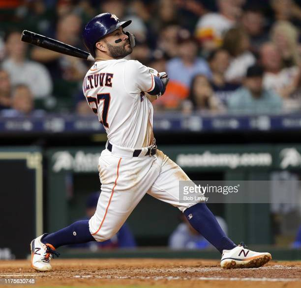 Jose Altuve of the Houston Astros hits a home run in the seventh inning against the Texas Rangers at Minute Maid Park on September 18, 2019 in...