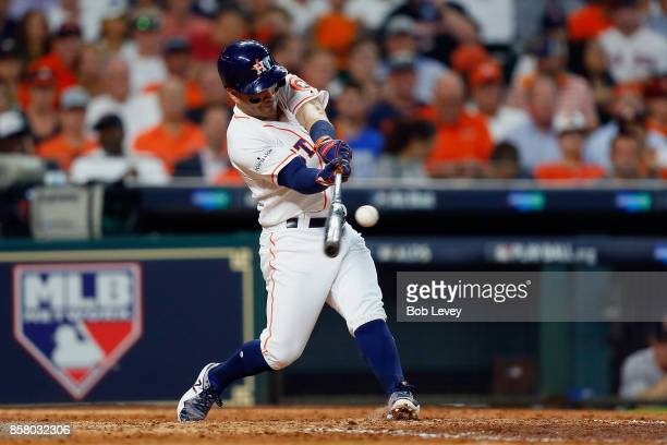 Jose Altuve of the Houston Astros hits a home run in the seventh inning against the Boston Red Sox during game one of the American League Division...