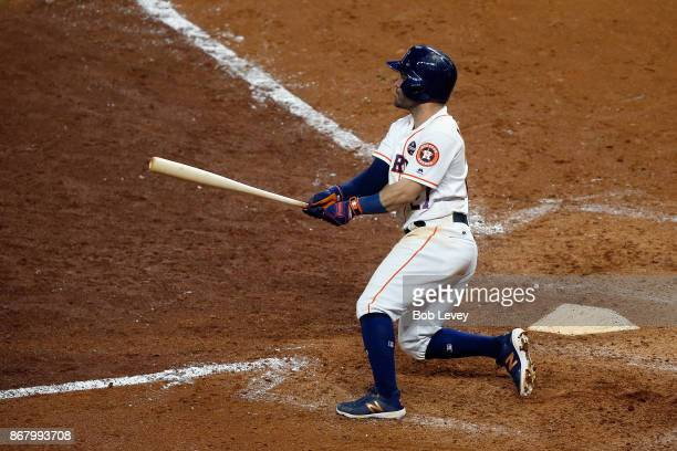Jose Altuve of the Houston Astros hits a RBI double dyi against the Los Angeles Dodgers in game five of the 2017 World Series at Minute Maid Park on...