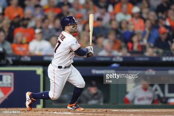 Jose Altuve of the Houston Astros hits a single in the first inning against the Boston Red Sox during Game Five of the American League Championship...