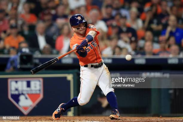 Jose Altuve of the Houston Astros hits a single in the fourth inning against the New York Yankees during game one of the American League Championship...