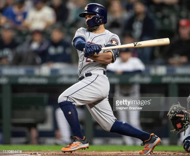 Jose Altuve of the Houston Astros hits a single off of starting pitcher Justin Dunn of the Seattle Mariners during the first inning of a game at...