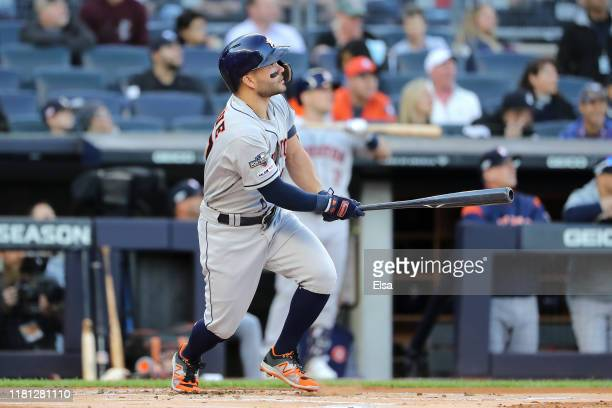 Jose Altuve of the Houston Astros hits a solo home run during the first inning against the New York Yankees in game three of the American League...