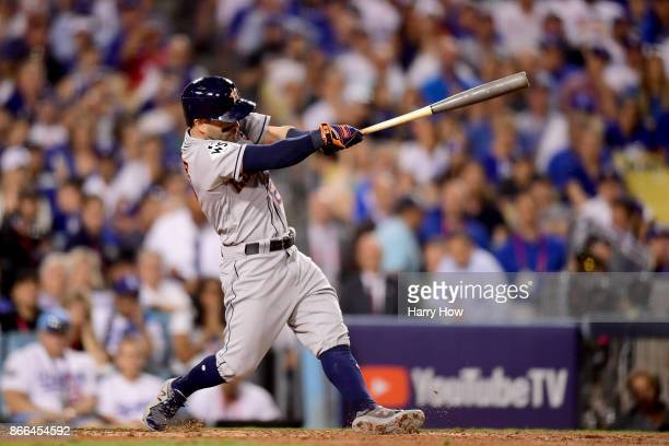 Jose Altuve of the Houston Astros hits a solo home run during the tenth inning against the Los Angeles Dodgers in game two of the 2017 World Series...