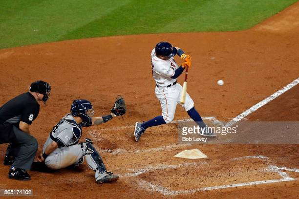 Jose Altuve of the Houston Astros hits a solo home run in the fifth inning against the New York Yankees in Game Seven of the American League...
