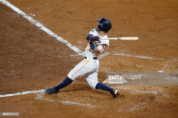 Jose Altuve of the Houston Astros hits a threerun home run during the fifth inning against the Los Angeles Dodgers in game five of the 2017 World...