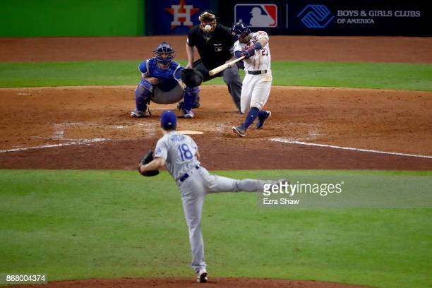 Jose Altuve of the Houston Astros hits a threerun home run during the fifth inning against Kenta Maeda of the Los Angeles Dodgers in game five of the...