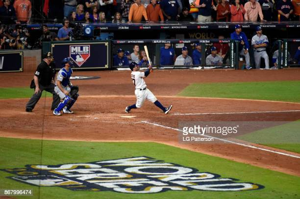 Jose Altuve of the Houston Astros hits a three-run home run in the fifth inning during Game 5 of the 2017 World Series against the Los Angeles...