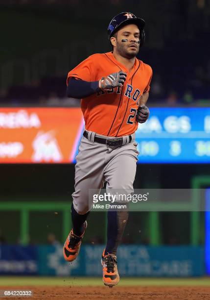 Jose Altuve of the Houston Astros hits a triple in the third inning during a game against the Miami Marlins at Marlins Park on May 17 2017 in Miami...