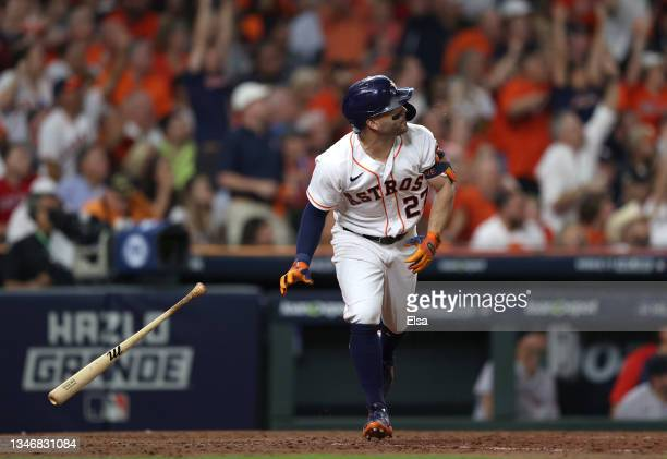 Jose Altuve of the Houston Astros hits a two-run home run in the sixth inning against the Boston Red Sox during Game One of the American League...