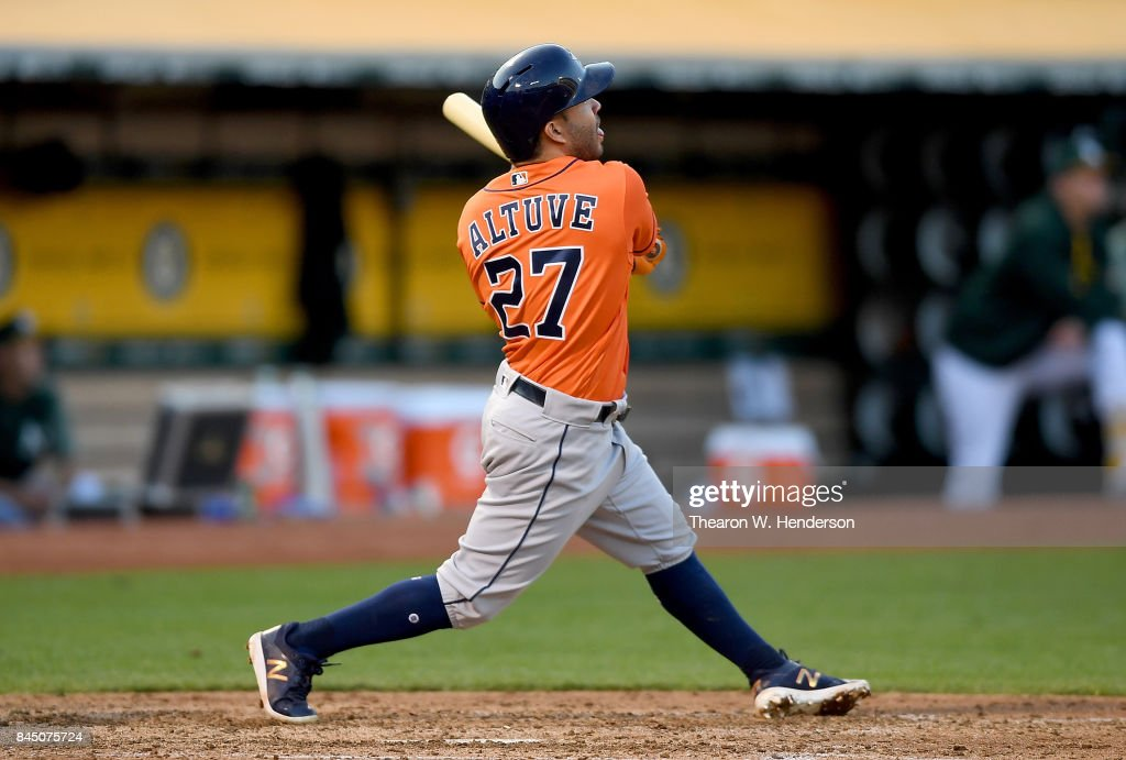 Jose Altuve #27 of the Houston Astros hits a two-run homer against the Oakland Athletics in the top of the six inning of the second game in a double header at Oakland Alameda Coliseum on September 9, 2017 in Oakland, California.