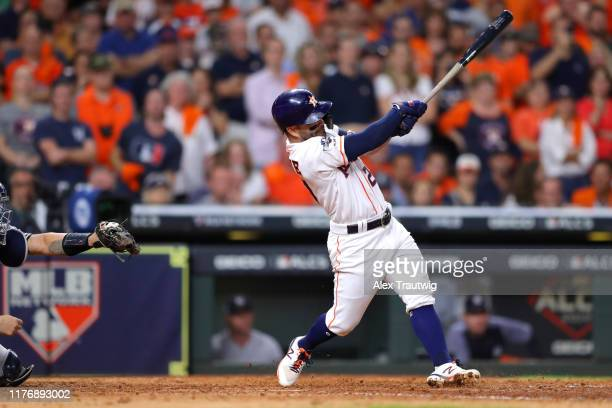 Jose Altuve of the Houston Astros hits a tworun walkoff home run to win the ALCS and advance the Houston Astros to the World Series during the ninth...