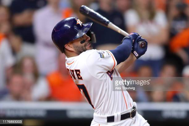 Jose Altuve of the Houston Astros hits a two-run walk-off home run to win the ALCS and advance the Houston Astros to the World Series during the...