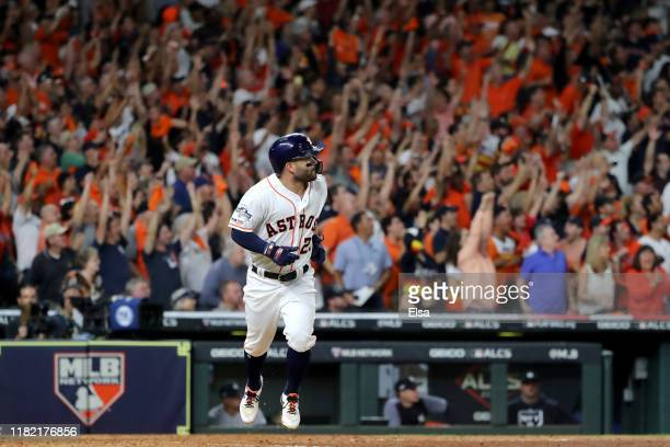 Jose Altuve of the Houston Astros hits a walk-off two-run home run to win game six of the American League Championship Series 6-4 against the New...