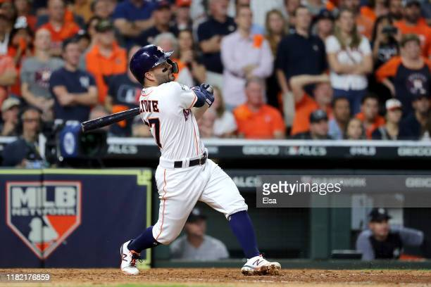 Jose Altuve of the Houston Astros hits a walkoff tworun home run to win game six of the American League Championship Series 64 against the New York...