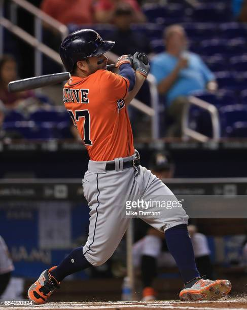 Jose Altuve of the Houston Astros hits an RBI double in the first inning during a game against the Miami Marlins at Marlins Park on May 17 2017 in...