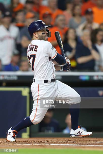Jose Altuve of the Houston Astros hits an RBI single against the Tampa Bay Rays during the first inning in game five of the American League Division...