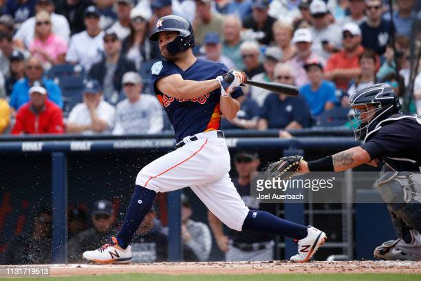 Jose Altuve of the Houston Astros hits into a fielders choice against the New York Yankees during a spring training game at The Fitteam Ballpark of...