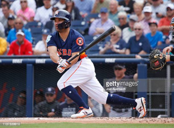 Jose Altuve of the Houston Astros hits the ball against the New York Yankees during a spring training game at The Fitteam Ballpark of the Palm...