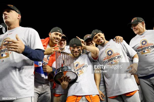 Jose Altuve of the Houston Astros holds the Commissioner's Trophy after defeating the Los Angeles Dodgers 51 in game seven to win the 2017 World...