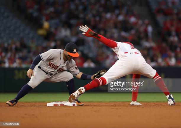 Jose Altuve of the Houston Astros holds the tag on Cameron Maybin of the Los Angeles Angels of Anaheim on the steal attempt at second base during the...