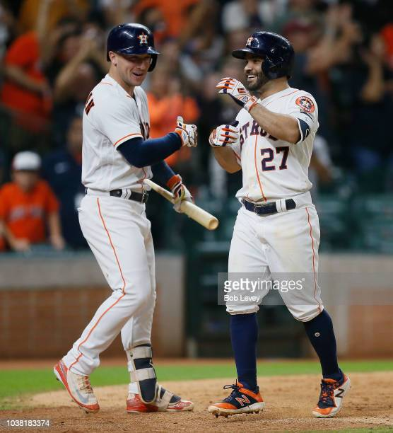 Jose Altuve of the Houston Astros is congratulated by Alex Bregman after a tworun home run in the eighth inning against the Los Angeles Angels of...