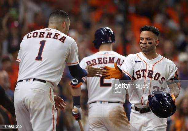 Jose Altuve of the Houston Astros is congratulated by Carlos Correa after he hit a two-run home run in the sixth inning against the Boston Red Sox...