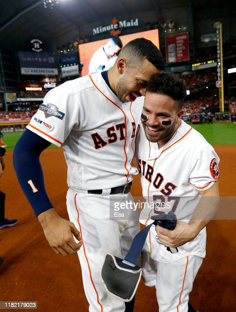 Jose Altuve of the Houston Astros is congratulated by his teammate Carlos Correa following his ninth inning walk-off two-run home run to defeat the...