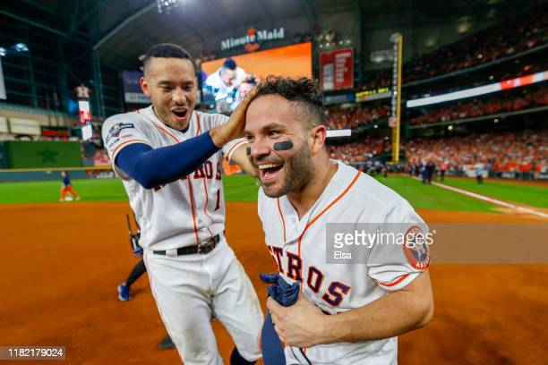 Jose Altuve of the Houston Astros is congratulated by his teammate Carlos Correa following his ninth inning walkoff tworun home run to defeat the New...