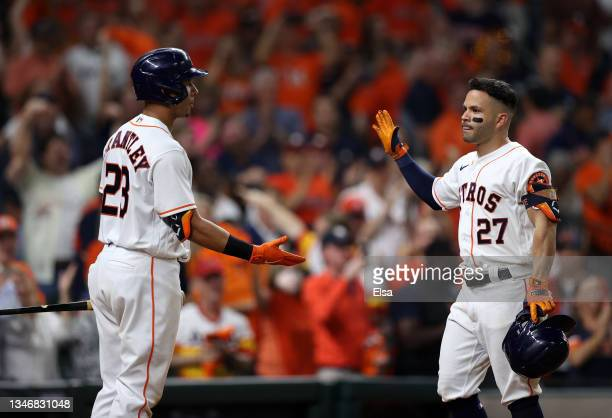 Jose Altuve of the Houston Astros is congratulated by Michael Brantley after he hit a two-run home run in the sixth inning against the Boston Red Sox...