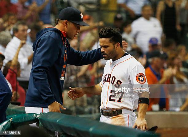 Jose Altuve of the Houston Astros is greeted by George Springer after Altuve scored a run in the eighth inning during their game against the Tampa...