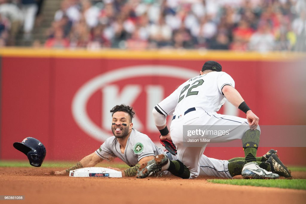 Jose Altuve #27 of the Houston Astros is safe last second on a stolen base as second baseman Jason Kipnis #22 of the Cleveland Indians tries to make the tag during the first inning at Progressive Field on May 26, 2018 in Cleveland, Ohio.
