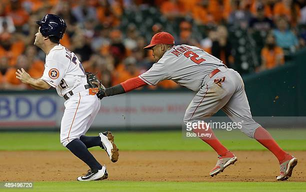 Jose Altuve of the Houston Astros is tagged by Erick Aybar of the Los Angeles Angels of Anaheim as he was picked off second base in the third inning...