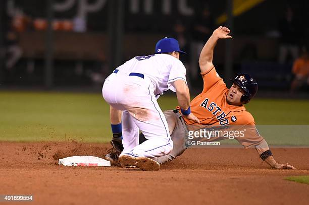 Jose Altuve of the Houston Astros is tagged out by Ben Zobrist of the Kansas City Royals on an attempted steal during Game 1 of the ALDS at Kauffman...