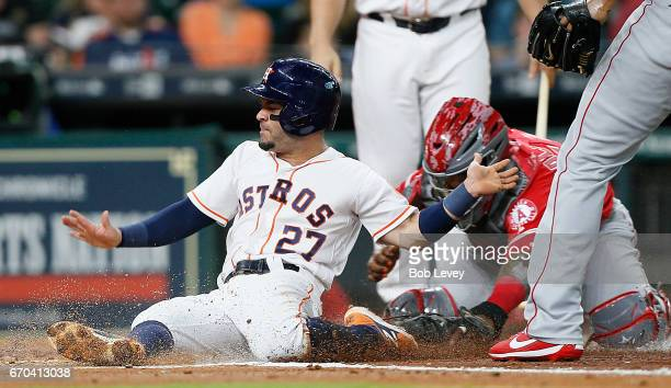 Jose Altuve of the Houston Astros is tagged out by Martin Maldonado of the Los Angeles Angels of Anaheim as he attempted to score on a pitch from JC...