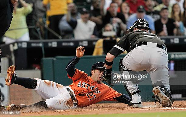 Jose Altuve of the Houston Astros is tagged out by Tyler Flowers of the Chicago White Sox in the first inning at Minute Maid Park on May 29 2015 in...