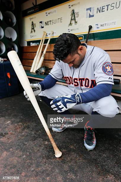 Jose Altuve of the Houston Astros kneels in the dugout prior to the game against the Oakland Athletics at Oco Coliseum on April 24 2015 in Oakland...