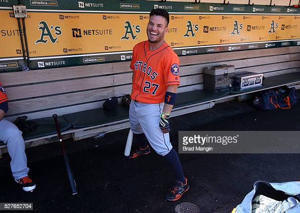 Jose Altuve of the Houston Astros laughs in the dugout before the game against the Oakland Athletics at the Oakland Coliseum on Saturday April 30...
