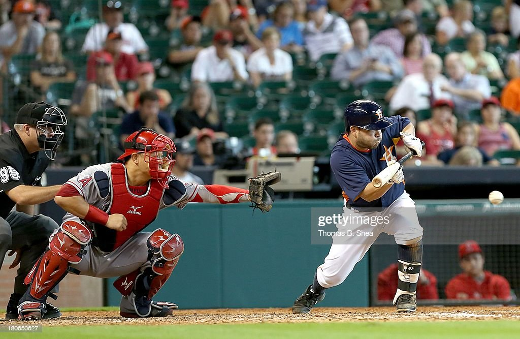 Jose Altuve #27 of the Houston Astros lays down a sacrifice bunt against the Los Angeles Angels of Anaheim in the eighth inning on September 15, 2013 at Minute Maid Park in Houston, Texas.