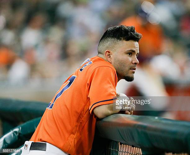 Jose Altuve of the Houston Astros loks on from the dugout in the sixth inning against the Texas Rangers at Minute Maid Park on May 20 2016 in Houston...