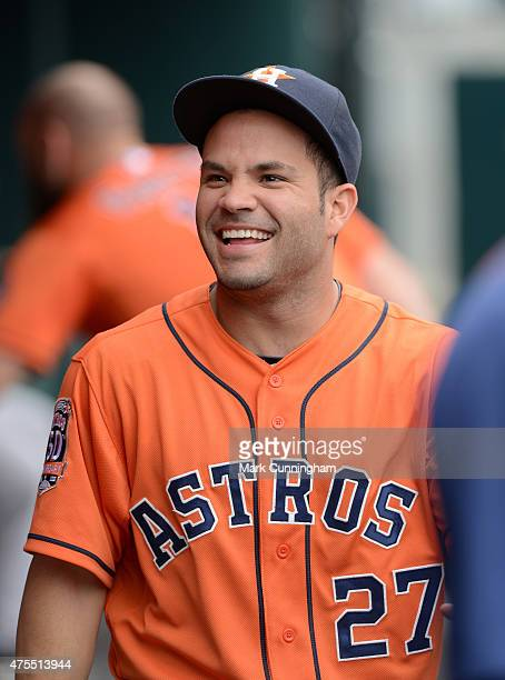 Jose Altuve of the Houston Astros looks on and smiles from the dugout during the game against the Detroit Tigers at Comerica Park on May 24 2015 in...