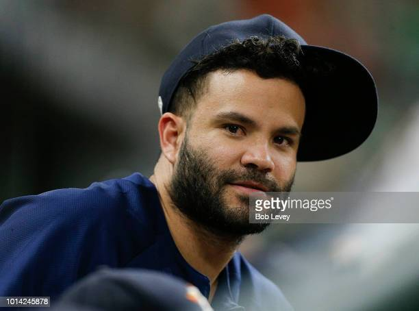 Jose Altuve of the Houston Astros looks on from the bench at Minute Maid Park on August 9 2018 in Houston Texas